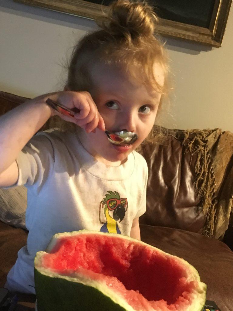 Riley eating watermelon
